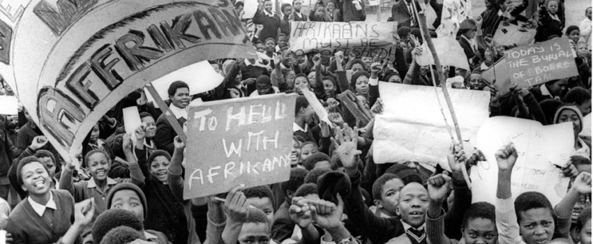 DM2000081409:SAED:APARTHEID:JUL1976 - The day Our Kids Lost Faith - marching Kids, in a mood common to school kids the world over, happy that they were not in class, good naturedly protesting against the use of Afrikaans a amedium of instruction at their schools. They march from Naledi Township, at the south  western end of Soweto, collecting others on their route to Orlando East, the north eastern end of the vast complex. If the police had not tried to wrest the posters from the children, if they had not tried to arrest any of them, if they had not tried to set dogs on to them, if they had not fired shots, June 16 would not have been as black a day as it turned out to be. (Photograph by Mike Mzileni  Baileys Archives)